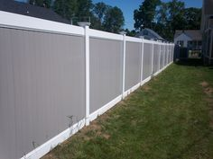 Want to add a little twist to your standard vinyl fence? Check out our 6' high vinyl privacy fence with a white frame and grey vinyl board inserts. #fencesdoneright #haleybrosfence #fence #vinylfence #mixandmatch #outdoorliving