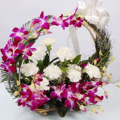 View detailed images (1)  Basket Arrangement of 5 Orchids and 6 White Carnations