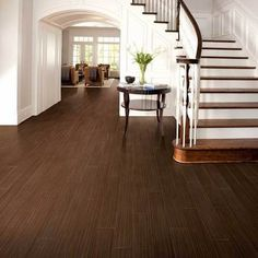 American Olean Ebony Wood Tile on the floor. Available at WCT Design Flooring. Hardwood Tile, Wood Tile Floors, Wood Look Tile, Wood Planks, Laminate Flooring, Porch Flooring, Wood Wood, Basement Remodel Diy, Basement Remodeling