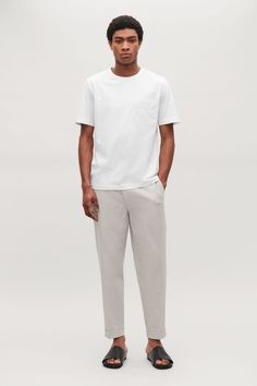 Model front image of Cos relaxed turn-up trousers in neutral