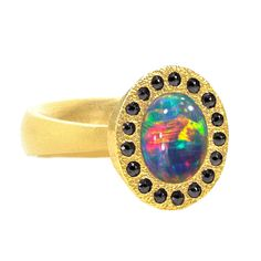 One of a Kind Intense Red Flash Lighting Ridge Opal Black Diamond Gold Ring | See more rare vintage Cocktail Rings at http://www.1stdibs.com/jewelry/rings/cocktail-rings