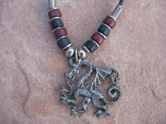 Black Leather Necklace with a Pewter Dragon by buffalorunjewelry, $11.95