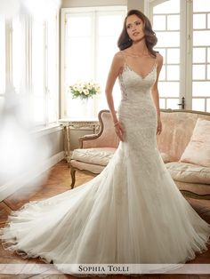 mon cheri bridals Y11707 Margot - Sleeveless misty tulle fit and flare gown with slender illusion shoulder straps and soft sweetheart illusion neckline edged with crystal hand-beading, beaded lace appliqués generously adorn bodice and trail off down skirt, beaded illusion sides and low V-back adorned in matching appliqué, back zipper trimmed with tulle and satin buttons, chapel length train.  Also available with solid back as Y11707SB.