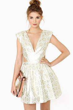 love the fabric, and the cutouts of this dress! pretty pretty