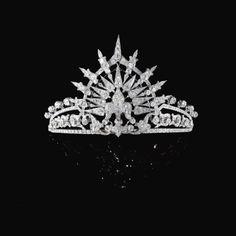 DIAMOND TIARA, CIRCA 1900,  Bavaria Princess Ursula's Diamond Tiara, The central fleur-de-lys motif set en tremblant to a Tiara composed of foliate and lanceolated motifs, set with Cushion-shaped, Circular-cut and Rose Diamonds, accompanied by a detachable Tiara frame, This tiara was originally part of the wedding present from Queen Isabella II of Spain to her daughter Infanta María de la Paz, Princess of Bourbon (b.1862-1946),  ç