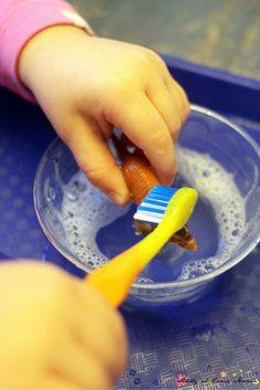 Scrub dinosaurs to teach children how to brush their teeth
