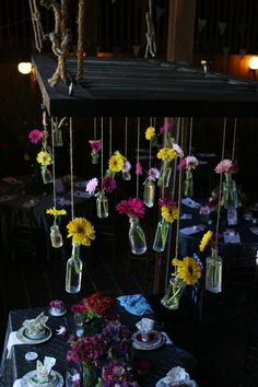 Here's another great reception decor idea.  Hang bottles of gerbera daisies from a vintage door above a table.  wedding decor ideas.  vintage wedding. rustic wedding. wedding reception.  wedding decor ideas.