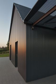 Image 15 of 36 from gallery of Saint-Sauveur House / Hors-Champs. Photograph by Cyrille Lallement House Cladding, Metal Cladding, Metal Siding, Barn House Conversion, Black House Exterior, Modern Barn House, Steel Barns, Saint Sauveur, Shed Homes