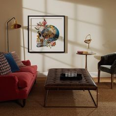 Who says skull prints can't be elegant? Pair with brass accessories and coral upholstery for a bold, contemporary look. Decorative Objects, Decorative Accessories, Skull Painting, Sitting Rooms, Collage Frames, Skull Print, Objet D'art, Tropical Flowers, Upholstery