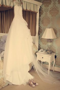 I love pictures of the dress hanging before the bride gets ready :)
