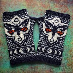 These fingerless mitts feature a pair of underwing moths (known for the striking color on their hind wings that is often hidden from view) accompanied by a moon phase motif reflecting their nocturnal nature. A wide figurative panel on the back of each mitt wraps around to meet a narrower panel along the palm side of the mitt. This pattern is recommended for knitters who have experience with stranded colorwork, reading from charts, knitting in the round, and adding duplicate stitch. The…