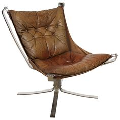 Falcon Chair by Sigurd Resell | From a unique collection of antique and modern lounge chairs at https://www.1stdibs.com/furniture/seating/lounge-chairs/