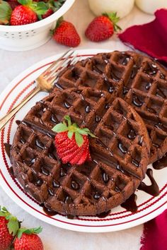 Chocolate waffles topped with a sweet strawberry..