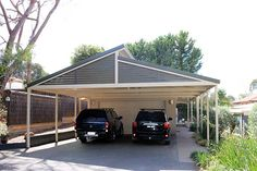 This Saw-tooth Gabled Carport adjacent to garage.
