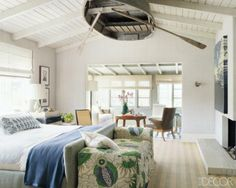 A vintage Abercrombie & Fitch rowboat is suspended from the master bedroom ceiling of Jeffery Alan Marks and the bench, designed by Jeffrey Alan Marks, is covered in a Christopher Farr linen print. Photographer: Simon Upton Designer: Jeffrey Alan Marks June 2010