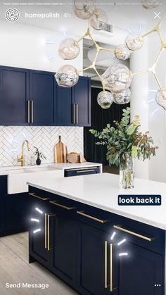 Blue cabinets + herringbone backsplash ❤️