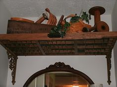 Printer's tray upside down and brackets added to make a shelf.  Awesome ! (from JunkSituation)