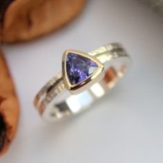 Tanzanite silver and gold ring