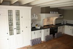 Nieuwe tegels op oude tegels in keuken werkspot