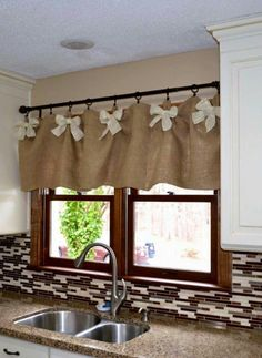 Burlap and White DIY Kitchen Valances. We werent sure if we could create kitchen… Minus the bows. Not really a bow girl. Burlap and White DIY Kitchen Valances. Source by Ideas on How to Choose the Right Styles of Kitchen Valances For Your Kitchen variou Kitchen Window Valances, Kitchen Window Treatments, Kitchen Windows, Kitchen Window Designs, Easy Window Treatments, Window Valences, Country Window Treatments, Kitchen Window Decor, Kitchen Decorations