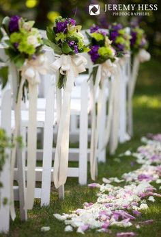 Flowers draping down the aisle adds a beautiful touch! We love the mix of purple and green with the long ribbons and petals.  Vendor: Petals with Style Pin from DreamWeddingsPA.com
