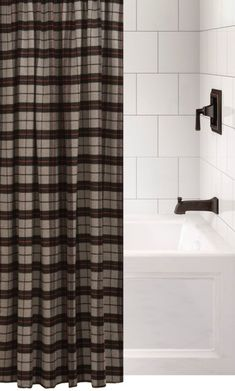 Custom made to order fabric shower curtain using our upgrade fabric called Ponderosa with black, red, and gray colors for a strikingly bold plaid pattern that is perfect for a more masculine bathroom. Made and Ships from Wooded River.