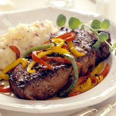 Sweet peppers top juicy, inch-thick steaks in this fast yet sensational dinner recipe.