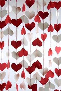 Happy Valentine's Day! make streamers from paper hearts stitched together