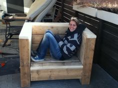 A DIY loveseat made out of scaffolding wood.