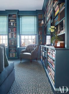 In the library of this Manhattan townhouse, designer Vicente Wolf hired an automotive painter to spray the built-in shelves with a metallic teal, giving the room a gloss reminiscent of the Finish Fetish movement of the '60s and '70s. #LeatherFlooring