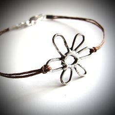 Sterling May Flower bracelet on linen by JewelryByMaeBee on Etsy. $22