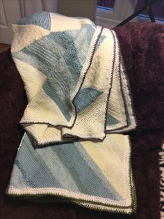 Carol Charnock Creation 👍 - this was originally a large bedspread with I undid to make these two small blankets with several squares left to convert into cat blankets.