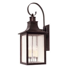 Cast an inviting glow over your sunroom or patio with this handsome wall lantern, showcasing an English bronze-finished and seeded glass panels....