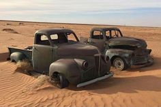 40ies Studebaker pickup & early 50ies Chevy pickup abandoned in the desert sand.