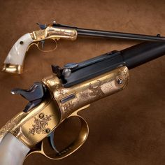 Annie Oakley Engraved Stevens Pistol- Noted sharpshooter Annie Oakley used this gold-plated rimfire pistol, fitted with mother-of-pearl grips for exhibition and trick shooting. Annie became a crackshot as a young girl to help feed her family with wild game. As the featured performer of Buffalo Bill's Wild West show she achieved international acclaim, toured two continents, and may be considered America's first female superstar. At the NRA National Firearms Museum in Fairfax, Virginia.
