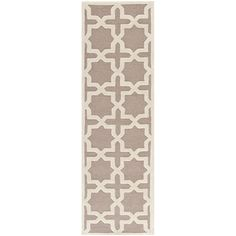 Anchor your dining set or living room seating group in chic style with this hand-tufted wool rug, showcasing a trellis motif in beige and ivory.