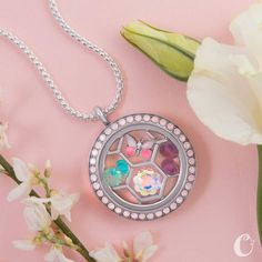 Spring is in the air and what does that mean? Yes it is time for New Origami Owl New Products and catalogs. Our new sneak peek has been released and we are so super excited with everything coming our way. We know you are going to fall in love with all of our new products, limited editions, mother's day products and so much more. Check out our sneak peek first so I can see how excited you get about all of our new Origami Owl products.
