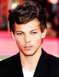 I think I just died. Is it hot in here or is it just Louis Tomlinson?