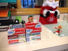 Elf on the Shelf! Here's our mischievous little elves having a snowball fight, they even built a fort out of toothpaste boxes!  Dr. Maggie Davis Pediatric Dentist Palm Harbor, FL