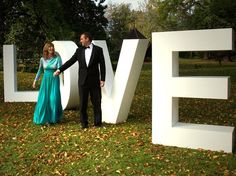 Huge letters as a backdrop - an original idea. Here for a wedding spelling L O V E