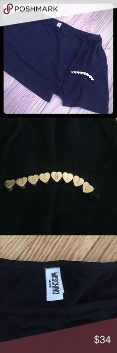 """Moschino swim skirt cover up! Super cute! 👙 Super cute swim cover up skirt made of swim material! Has a small slit and a tie (for decoration) with the heart shaped beads. Stretch material but measures 26"""" circumference and is 10"""" long. MAKE IT A BUNDLE FOR 10% off or make an offer!!! Moschino Swim Coverups"""