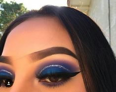 Blue half cut crease with glitter eyeliner the brows could be better ... look to fake