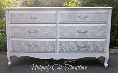 Spray-painted lace makes this dresser look fancy and fun at the same time.  Get the tutorial at Uniquely Chic Furniture.