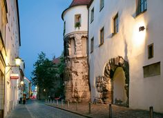 Germany's most ancient stone building, the Porta Praetoria, a gateway dating from 179 A. D. Giant blocks of stone were used to construct this gate in the northern wall of the Roman military camp. It survives as a reminder of Castra Regina, the Roman settlement.