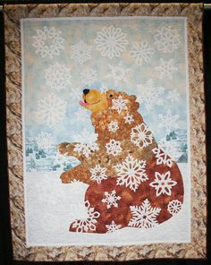 Bear Quilt by Anne Francis - interestingly, she used french knots to quilt layers together, to resemble falling snow, maybe?