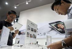 Summary Box: China faces conflict in iPad row