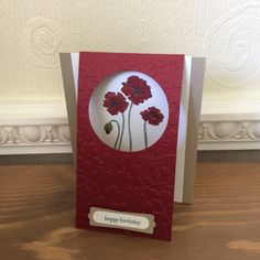 Flip card using Stampin Up embossing folder, crumb cake and cherry cobbler inks. Stampendous poppy stamp