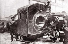 This photo demonstrates the often monstrous sizes of WW1 guns aiming to hurl huge projectiles as far as 25 miles. This one is most likely a coastal gun, its breach being calibrated by technicians. Firing these monsters required the crew to stay well clear of the gun -- as far as 50 meters from the breach -- and fire it by a pull cable. The resulting blast easily blinded those uncaring ones who insisted on looking. The force of the combustion required re-sighting the gun after every shot.