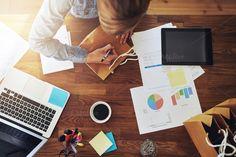 Female entrepreneur working at desk by Stefan & Janni on Creative Market