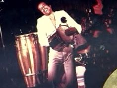 Carlinhos Pandeiro de Ouro playing a *cuica* drum at a jazz festival, Norway, 1974, courtesy Carlinhos Pandeiro de Ouro
